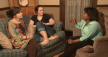 Three women sitting on a couch talking